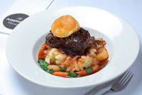 Beef Cheeks slow cooked in red wine, cream, mushroom and onion served on creamy mash & vegetables.